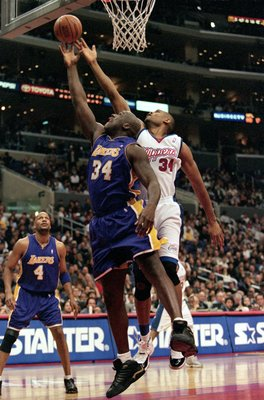 30 Dec 2000:  Shaquille O''Neal #34 of the Los Angeles Lakers and  Michael Olowokandi #34 of the Los Angeles Clippers jump for the ball by the net during the game at the STAPLES Center in Los Angeles, California.  The Lakers defeated the Clippers 116-114.
