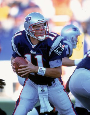 17 Sep 2000: Quarterback Drew Bledsoe #11 of the New England Patriots moves back with the ball during a game against the Minnesota Vikings at the Foxboro Stadium in Foxboro, Massachusetts. The Vikings defeated the Patriots 21-13. Mandatory Credit: Rick St