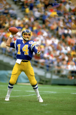 SAN DIEGO, CA - 1983:  Quarterback Dan Fouts #14 of the San Diego Chargers drops back to pass during a game at Jack Murphy Stadium during the 1983 NFL season in San Diego, California.  (Photo by Tony Duffy/Getty Images)