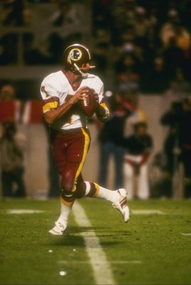 22  Jan 1984:   Quarterback Joe Theismann of the Washington Redskins prepares to pass during Super Bowl XVIII against the Los Angeles Raiders at Tampa Stadium in Tampa, Florida.  The Raiders won the game, 38-9. Mandatory Credit: Allsport  /Allsport