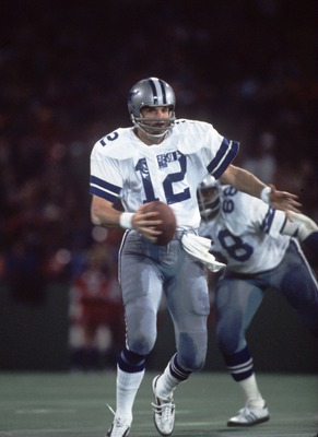 1979:  Quarterback Roger Staubach #12 of the Dallas Cowboys rolls out of the pocket during a Cowboys game in the 1979 season.   Mandatory Credit: Allsport/ALLSPORT