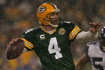 GREEN BAY, WI - JANUARY 12:  Quarterback Brett Favre #4 of the Green Bay Packers throws the ball in the fourth quarter against the Seattle Seahawks during the NFC divisional playoff game on January 12, 2008 at Lambeau Field in Green Bay, Wisconsin.  (Phot