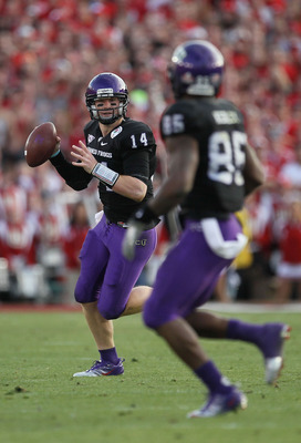 PASADENA, CA - JANUARY 01:  Quarterback Andy Dalton #14 of the TCU Horned Frogs looks to pass against the Wisconsin Badgers during the 97th Rose Bowl game on January 1, 2011 in Pasadena, California.  (Photo by Stephen Dunn/Getty Images)
