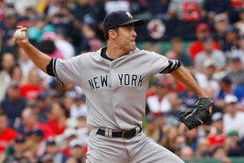 BOSTON - SEPTEMBER 28: Mike Mussina #35 of the New York Yankees throws against the Boston Red Sox at Fenway Park September 28, 2008 in Boston, Massachusetts. (Photo by Jim Rogash/Getty Images)
