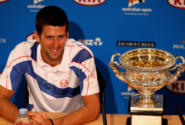 MELBOURNE, AUSTRALIA - JANUARY 30:  Novak Djokovic of Serbia poses with the Norman Brookes Challenge Cup in the press conference following his win in the men's final match against Andy Murray of Great Britain during day fourteen of the 2011 Australian Ope