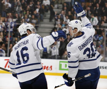 TORONTO, CANADA - JANUARY 20: Clarke MacArthur #16 and Carl Gunnarsson #36 of the Toronto Maple Leafs celebrate Carl Gunnarsson goal against the Anaheim Ducks during game action at the Air Canada Centre January 20, 2011 in Toronto, Ontario, Canada. (Photo