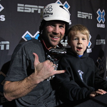 ASPEN, CO - JANUARY 29:  Nick Baumgartner of the USA poses for a photo with his son Landon after winning the gold medal in the Men's Snowboarder X at Winter X Games 15 at Buttermilk Mountain on January 29, 2011 in Aspen, Colorado.  (Photo by Doug Pensinge