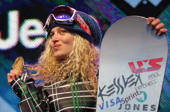 ASPEN, CO - JANUARY 29:  Lindsey Jacobellis of the USA takes the podium after winning the gold medal in the Women's Snowboarder X at Winter X Games 15 at Buttermilk Mountain on January 29, 2011 in Aspen, Colorado.  (Photo by Doug Pensinger/Getty Images)