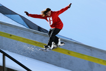 ASPEN, CO - JANUARY 28:  Nic Sauve of Canada slides a rail during practice for the Snowboard Street Event at Winter X Games 15 at Buttermilk Mountain on January 28, 2011 in Aspen, Colorado. The Snowboard Street Event is debuting at Winter X 15.  (Photo by