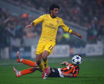DONETSK, UKRAINE - NOVEMBER 03: Carlos Vela of Arsenal battles with Razvan Rat of FC Shakhtar Donetsk during the Champions League Group H match between FC Shakhtar Donetsk and Arsenal at the Donbass Arena on November 3, 2010 in Donetsk, Ukraine.  (Photo b