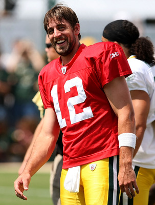 GREEN BAY, WI - AUGUST 05: Aaron Rodgers #12 of the Green Bay Packers smiles during a summer training camp practice on August 5, 2008 at the Hutson Center in Green Bay, Wisconsin. (Photo by Jonathan Daniel/Getty Images)