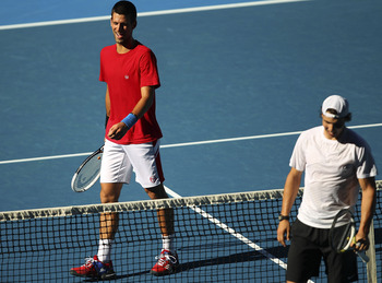 MELBOURNE, AUSTRALIA - JANUARY 14:  Novak Djokovic of Serbia and Rafael Nadal train together during a practice session ahead of the 2011 Australian Open at Melbourne Park on January 14, 2011 in Melbourne, Australia.  (Photo by Lucas Dawson/Getty Images)
