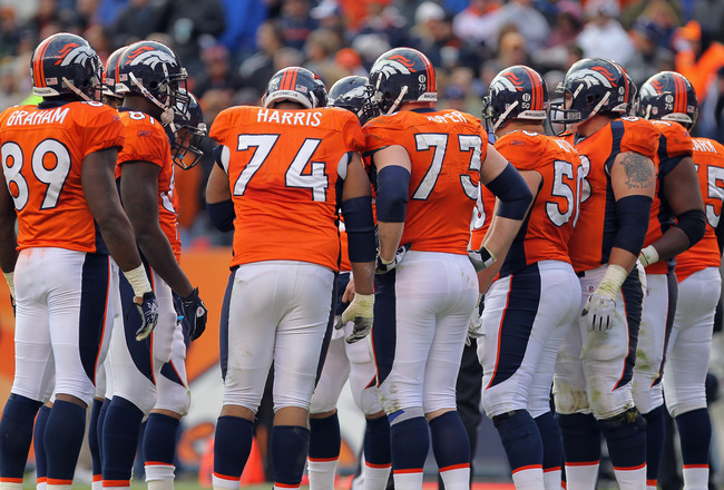 DENVER - NOVEMBER 14:  The Denver Broncos offensive huddles up to face the Kansas City Chiefs at INVESCO Field at Mile High on November 14, 2010 in Denver, Colorado. The Broncos defeated the Chiefs 49-29.  (Photo by Doug Pensinger/Getty Images)