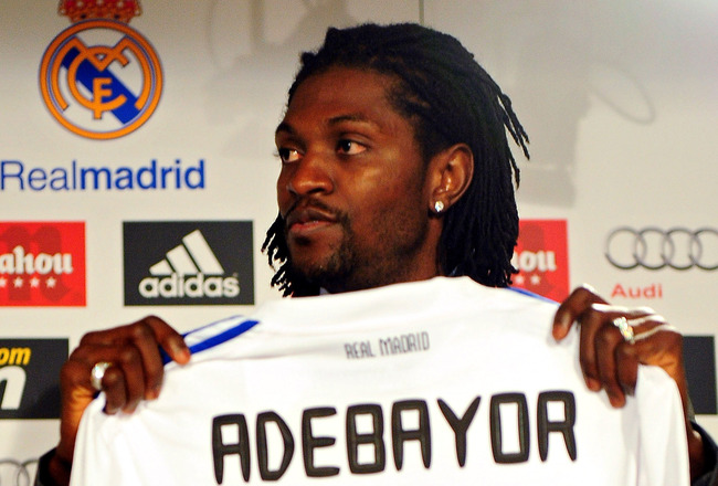 MADRID, SPAIN - JANUARY 27:  Emmanuel Adebayor holds up his new Real Madrid shirt during his presentation as a new Real Madrid player at Estadio Santiago Bernabeu on January 27, 2011 in Madrid, Spain.  (Photo by Denis Doyle/Getty Images)