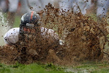 ENGLEWOOD, CO - AUGUST 05:  Zane Beadles #68 of the Denver Broncos dives into the mud as rookies partake in the slip and slide fumble drill during training camp at Dove Valley on August 5, 2010 in Englewood, Colorado.  (Photo by Doug Pensinger/Getty Image