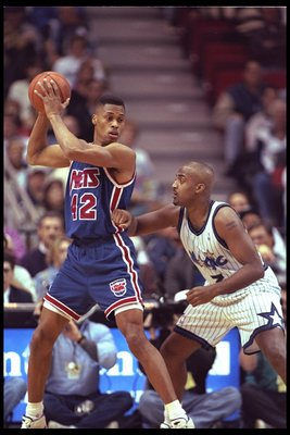 9 Jan 1996:  PJ Brown of the New Jersey Nets looks to pass against forward Dennis Scott of the Orlando Magic during a game played at the   Orlando Arena in Orlando, Florida.  The Magic won the game, 92-84. Mandatory Credit: ALLSPORT USA  /Allsport