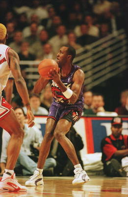 7 Nov 1995:  Guard Jimmy King of the Toronto Raptors focuses on the basket before attempting a shot during the Raptors 117-108 loss to the Chicago Bulls at the United Center in Chicago, Illinois.   Mandatory Credit: Jonathan Daniel/ALLSPORT