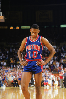 LOS ANGELES - 1988:  Dennis Rodman #10 of the Detroit Pistons walks on the court during a game against the Los Angeles Lakers at the Great Western Forum in Los Angeles, California in the 1988-1989 NBA season.  (Photo by Rick Stewart/Getty Images)