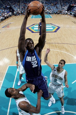 NEW ORLEANS - APRIL 19:  Brandon Bass #32 of the Dallas Mavericks dunks the ball over  the New Orleans Hornets in Game One of the Western Conference Quarterfinals during the 2008 NBA Playoffs at The New Orleans Arena on April 19, 2008 in New Orleans, Loui