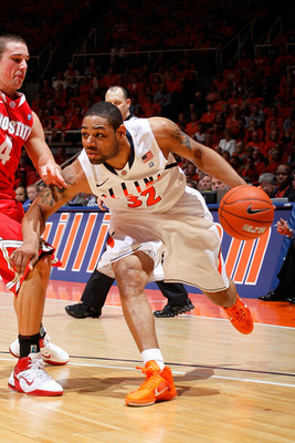 CHAMPAIGN, IL - JANUARY 22: Demetri McCamey #32 of the Illinois Fighting Illini tries to get to the basket while being defended by Aaron Craft #4 of the Ohio State Buckeyes at Assembly Hall on January 22, 2011 in Champaign, Illinois. Ohio State won 73-68.