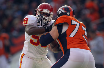 DENVER - NOVEMBER 14:  Offensive lineman Chris Kuper #73 of the Denver Broncos blocks against Jovan Belcher #59 of the Kansas City Chiefs at INVESCO Field at Mile High on November 14, 2010 in Denver, Colorado. The Broncos defeated the Chiefs 49-29.  (Phot