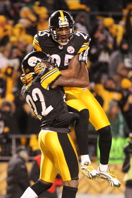 PITTSBURGH, PA - JANUARY 23:  William Gay #22 and Ryan Clark #25 of the Pittsburgh Steelers celebrate Gay's second quarter touchdown scored after Mark Sanchez #6 of the New York Jets fumbled during the 2011 AFC Championship game at Heinz Field on January