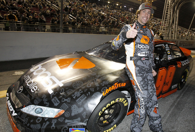 IRWINDALE, CA - JANUARY 29:  Travis Pastrana, driver of the #99 Boost Mobile Toyota, prepares to drive before the NASCAR Toyota All-Star Showdown at Toyota Speedway at Irwindale on January 29, 2011 in Irwindale, California.  (Photo by Todd Warshaw/Getty I