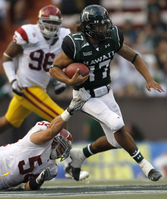 HONOLULU - SEPTEMBER 02: Bryant Moniz #17 of the University of Hawaii Warriors carries the ball during first half action against the University of Southern California Trojans at Aloha Stadium September 2, 2010 in Honolulu, Hawaii. (Photo by Kent Nishimura