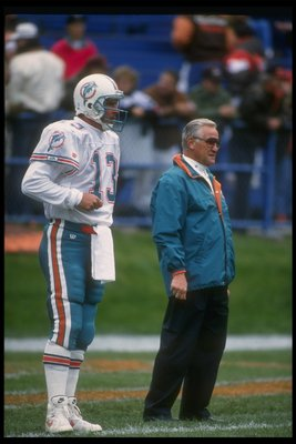 10 Oct 1993:  Miami Dolphins quarterback Dan Marino and head coach Don Shula look on during a game against the Cleveland Browns at Cleveland Stadium in Cleveland, Ohio.  The Dolphins won the game, 24-14. Mandatory Credit: Jonathan Daniel  /Allsport