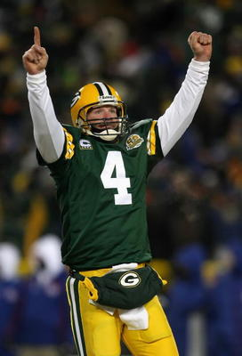 GREEN BAY, WI - JANUARY 20:  Quarterback Brett Favre #4 of the Green Bay Packers celebrates after throwing a 12 yard touchdown recption during the third quarter of the NFC championship game against the New York Giants on January 20, 2008 at Lambeau Field