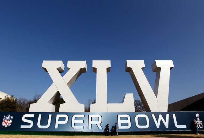 DALLAS, TX - JANUARY 30:  Football fans gather around a large Super Bowl XLV display on January 30, 2011 in downtown Dallas, Texas.  Cowboys Stadium will host Super Bowl XLV on February 6, 2011 between the Pittsburgh Steelers and the Green Bay Packers in