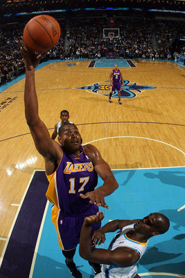 NEW ORLEANS, LA - DECEMBER 29:  Andrew Bynum #17 of the Los Angeles Lakers shoots the ball over Emeka Okafor #50 of the New Orleans Hornets at the New Orleans Arena on December 29, 2010 in New Orleans, Louisiana.   The Lakers defeated the Hornets 103-88.