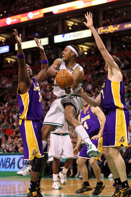BOSTON - JUNE 13:  Paul Pierce #34 of the Boston Celtics looks to pass against Lamar Odom #7 and Pau Gasol #16 of the Los Angeles Lakers during Game Five of the 2010 NBA Finals on June 13, 2010 at TD Garden in Boston, Massachusetts. NOTE TO USER: User exp