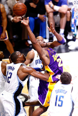 ORLANDO, FL - JUNE 14:  Kobe Bryant #24 of the Los Angeles Lakers goes up for a shot in front of Dwight Howard #12 of the Orlando Magic in the fourth quarter of Game Five of the 2009 NBA Finals on June 14, 2009 at Amway Arena in Orlando, Florida.  NOTE TO