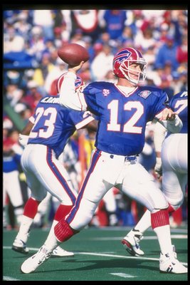 9 Oct 1994: Quarterback Jim Kelly of the Buffalo Bills throws the ball during a game against the Miami Dolphins at Rich Stadium in Orchard Park, New York. The Bills won the game, 21-11.