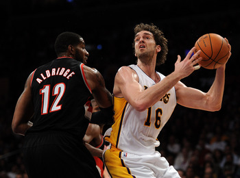 LOS ANGELES, CA - NOVEMBER 07:  Pau Gasol #16 of the Los Angeles Lakers prepares to shoot over LaMarcus Aldridge #12 of the Portland Trail Blazers during the first half at the Staples Center on November 7, 2010 in Los Angeles, California.  NOTE TO USER: U