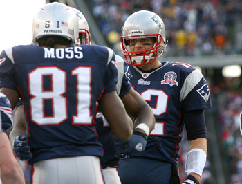 FOXBORO, MA - DECEMBER 27: Randy Moss #81 of the New England Patriots is congratulated by team mate Tom Brady #12 after catching his third touchdown pass of the day against the Jacksonville Jaguars in the fourth quarter at Gillette Stadium on December 27,