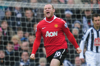 WEST BROMWICH, ENGLAND - JANUARY 01:  Wayne Rooney of Manchester United celebrates after scoring during the Barclays Premier League match between West Bromich Albion and Manchester United at The Hawthorns on January 1, 2011 in West Bromwich, England.  (Ph