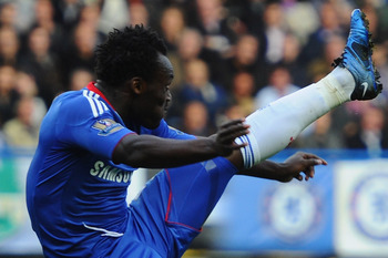 LONDON, ENGLAND - OCTOBER 03:  Michael Essien of Chelsea tries to control the ball during the Barclays Premier League match between Chelsea and Arsenal at Stamford Bridge on October 3, 2010 in London, England.  (Photo by Mike Hewitt/Getty Images)