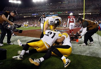 TAMPA, FL - FEBRUARY 01:  Teammates of Santonio Holmes #10 of the Pittsburgh Steelers jump on Holmes after he catches a 6-yard touchdown pass in the fourth quarter against the Arizona Cardinals during Super Bowl XLIII on February 1, 2009 at Raymond James