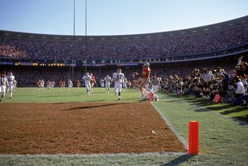 SAN FRANCISCO - JANUARY 20:  Wide receiver John Taylor #82 of the San Francisco 49ers hops into the end zone for a touchdown on a 61-yard pass from Joe Montana during the 1990 NFC Championship game against the New York Giants at Candlestick Park on Januar
