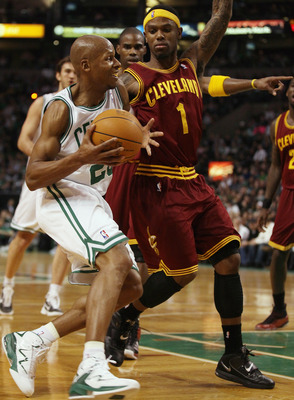 BOSTON, MA - JANUARY 25:  Ray Allen #20 of the Boston Celtics drives past Daniel Gibson #1  of the of the Cleveland Cavaliers on January 25, 2011 at the TD Garden in Boston, Massachusetts. The Celtics defeated the Cavaliers 112-95.  NOTE TO USER: User exp