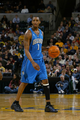 INDIANAPOLIS - DECEMBER 17:  Tracy McGrady #1 of the Orlando Magic moves the ball during the game against the Indiana Pacers on December 17, 2003 at Conseco Fieldhouse in Indianapolis, Indiana.  The Magic won 94-90.  NOTE TO USER: User expressly acknowled