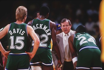 FEB 1987:  DALLAS COACH DICK MOTTA TALKS TO THE TEAM IN A HUDDLE DURING THE MAVERICKS GAME AT THE LOS ANGELES LAKERS. Mandatory Credit: Rick Stewart/ALLSPORT