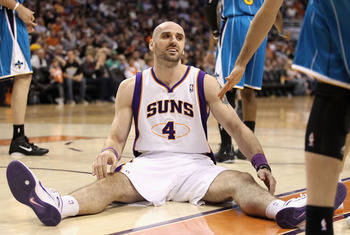 PHOENIX, AZ - JANUARY 30:  Marcin Gortat #4 of the Phoenix Suns reacts after falling to the court during the NBA game against the New Orleans Hornets at US Airways Center on January 30, 2011 in Phoenix, Arizona. The Suns defeated the Hornets 104-102.   NO