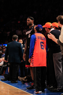NEW YORK, NY - JANUARY 27:  Film director Spike Lee talks to Lebron James #6 during the game between the Miami Heat and the New York Knicks at Madison Square Garden on January 27, 2011 in New York City. NOTE TO USER: User expressly acknowledges and agrees