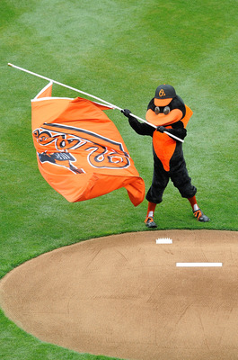 BALTIMORE - APRIL 06:  The Orioles Mascot carries a flag before the game between the Baltimore Orioles and the New York Yankees during opening day on April 6, 2009 at Camden Yards in Baltimore, Maryland.  (Photo by Greg Fiume/Getty Images)