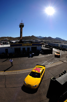 AVONDALE, AZ - NOVEMBER 12:  Dave Blaney, driver of the #36 Tommy Baldwin Racing Chevrolet, drives in the garage area during practice for the NASCAR Sprint Cup Series Kobalt Tools 500 at Phoenix International Raceway on November 12, 2010 in Avondale, Ariz