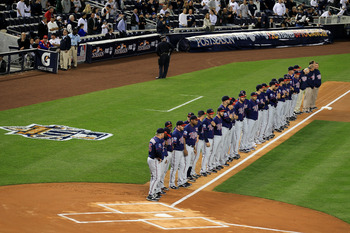 NEW YORK - OCTOBER 09:  The Minnesota Twins line up on the foul line during player introductions against the New York Yankees  during Game Three of the ALDS part of the 2010 MLB Playoffs at Yankee Stadium on October 9, 2010 in the Bronx borough of New Yor