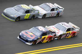 DAYTONA BEACH, FL - JANUARY 21:  Kasey Kahne, driver of the #4 Red Bull Toyota, and teammate Brian Vickers, driver of the #83 Red Bull Toyota, test their drafting skills against Jimmie Johnson, driver of the #48 Lowe's Chevrolet, and Tony Stewart, driver